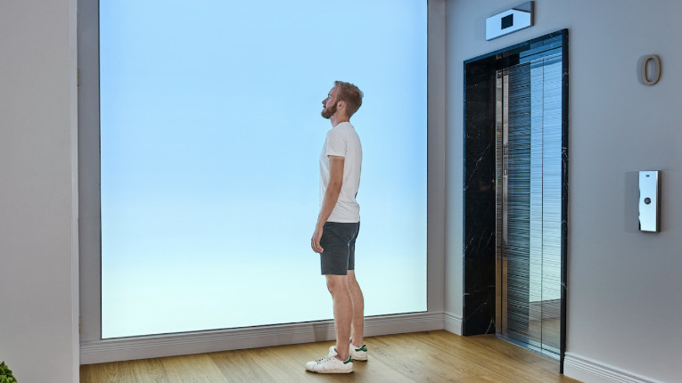 man standing in front of light