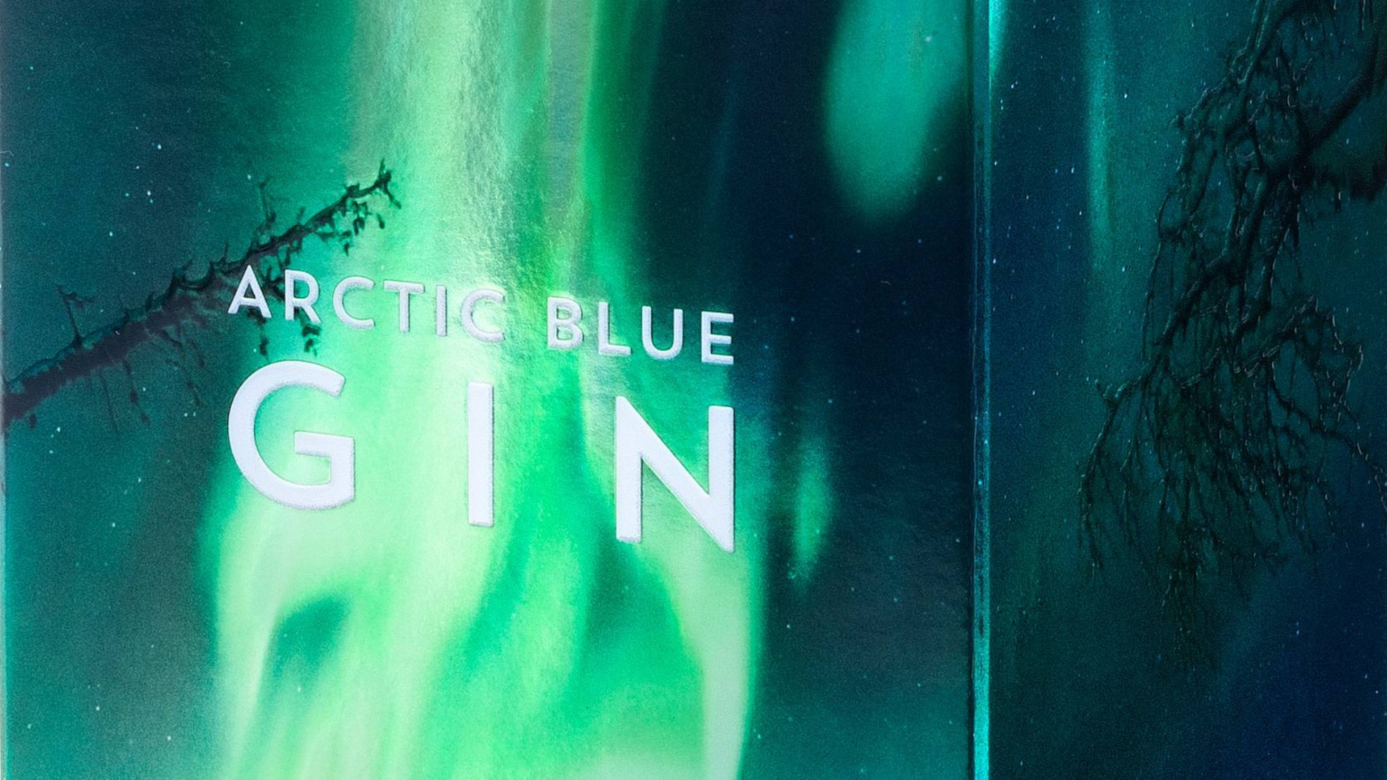 A gin packaging covered in the northern lights