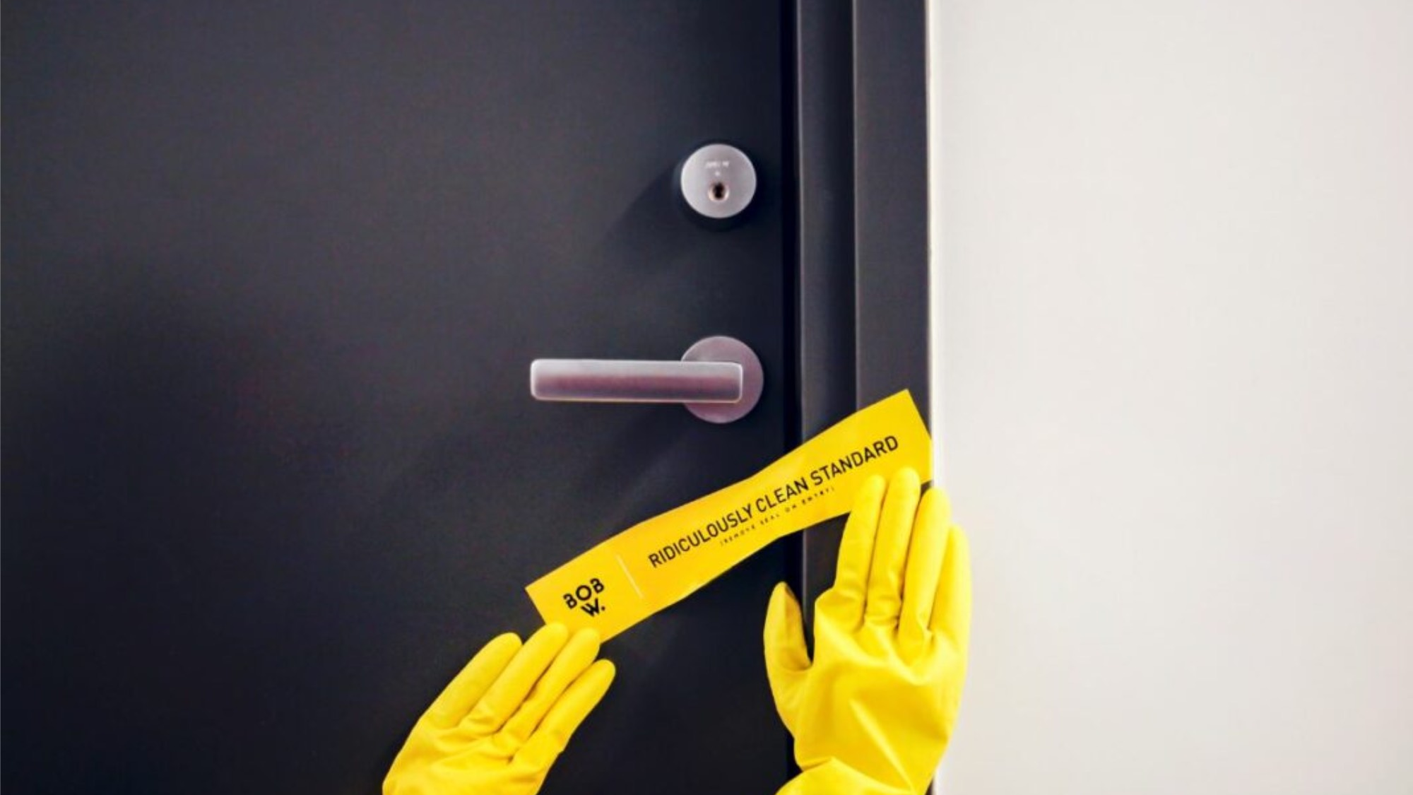 Yellow plastic gloves put a 'clean seal' on a door
