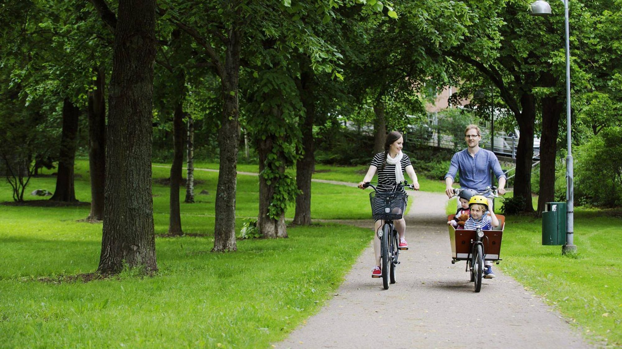 family cycling in a park
