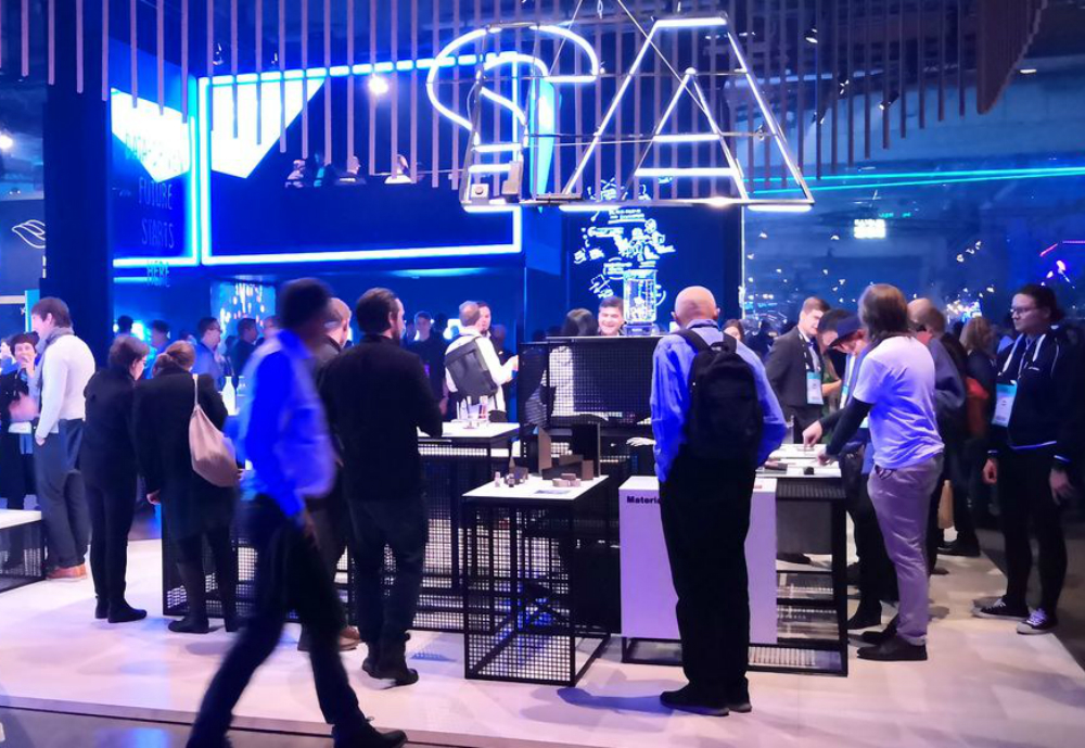 Startup exhibition with neon capital A sign