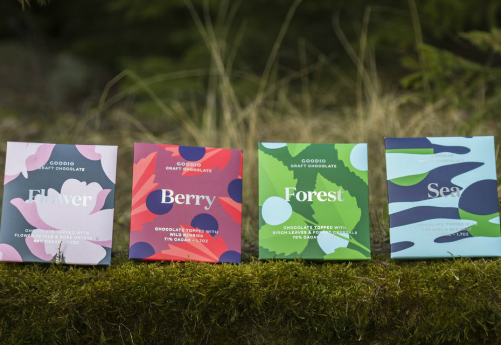 Goodio's Nordic Flavors chocolates net to each other in the forest.