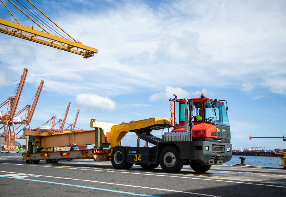 Terminal tractor carrying equipment in port