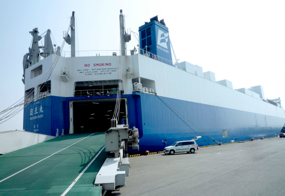 Vessel at harbour with open cargo ramp