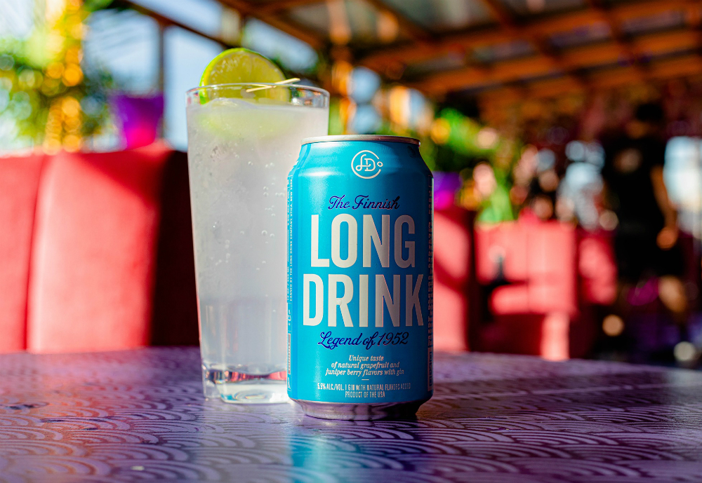 Long Drink can in front of full glass.