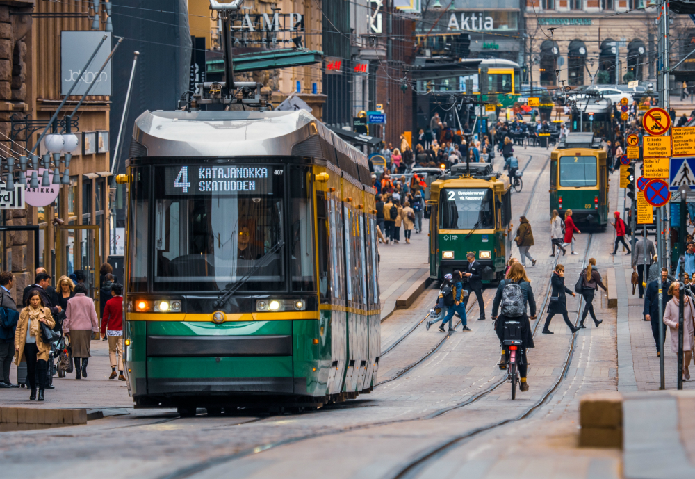 A tram and cyclists on busy street in Helsinki