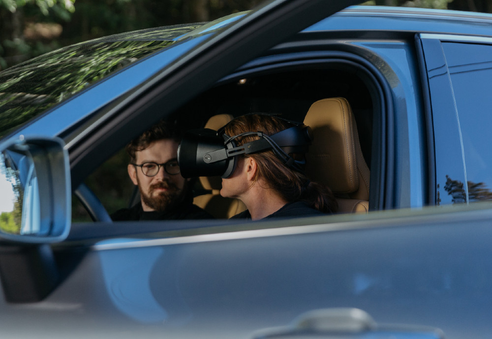 Car driver wearing VR headset