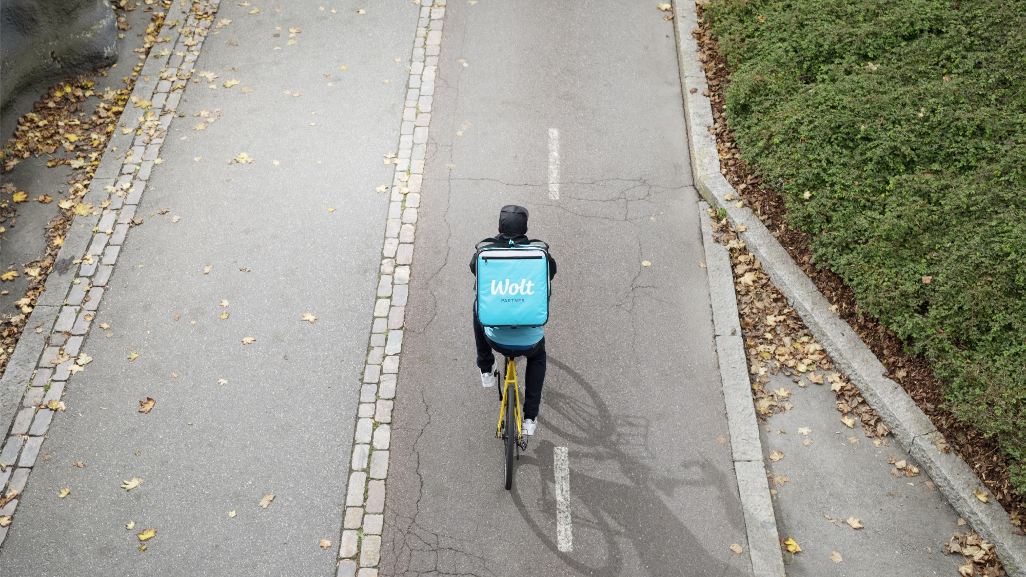 Food delivery courier cycling on road