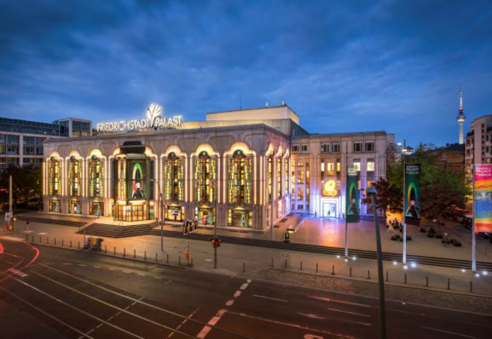 A lighted theatre building in the evening.