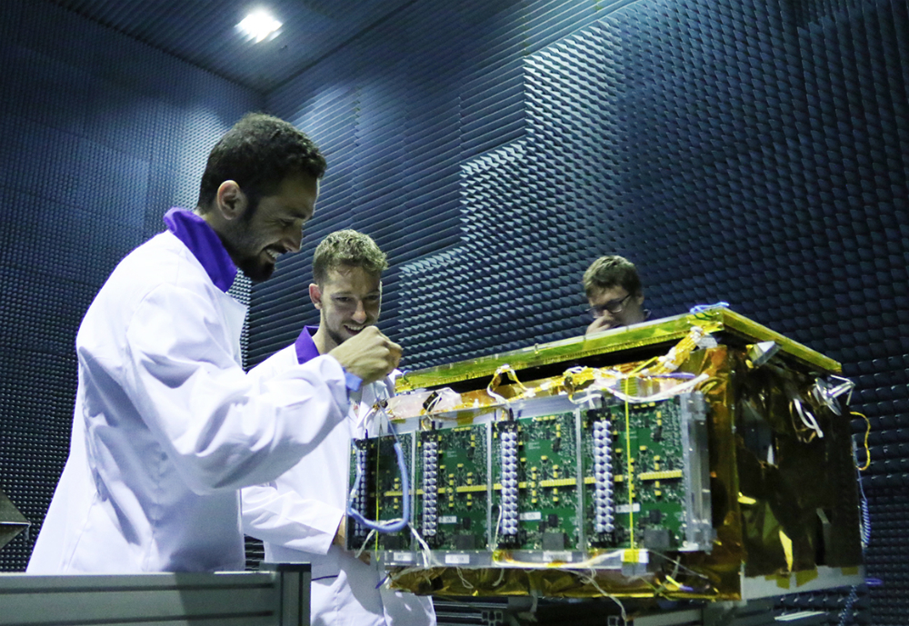 Scientists working on small satellite.
