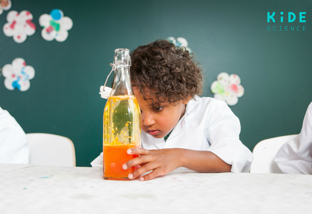 Child doing a science experiment.