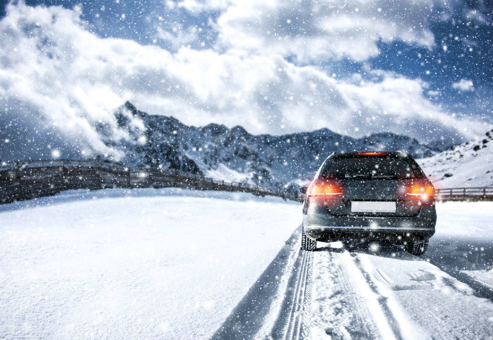 Car driving in snow.