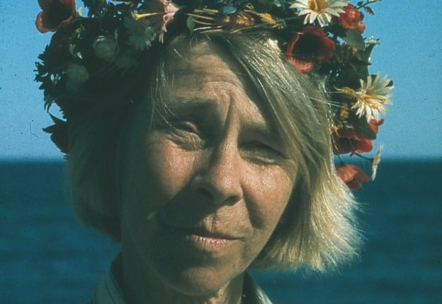 elderly woman with flowers in her hair