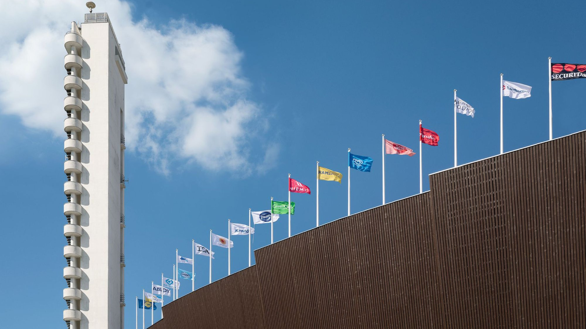 sports stadium tower and roof with flags
