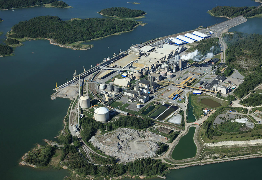 An aerial view of the factory surrounded by the sea and islands.