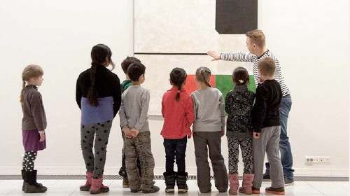 Children looking at a piece of art.