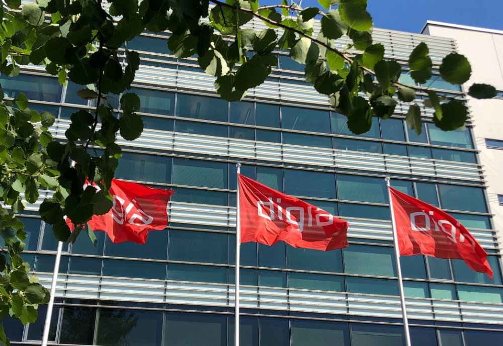 Three red Digia flags in front of an office building.