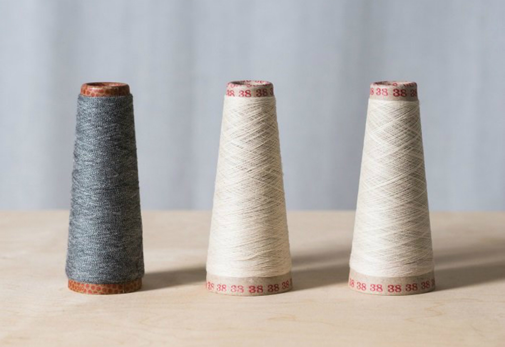 Different coloured yarns on a table.
