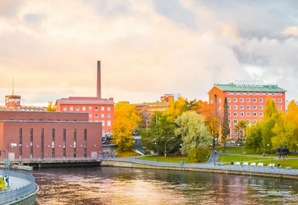 Industrial buildings by a river.