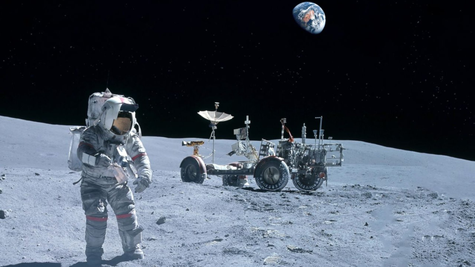 An astronaut and lunar rover on the lunar surface.