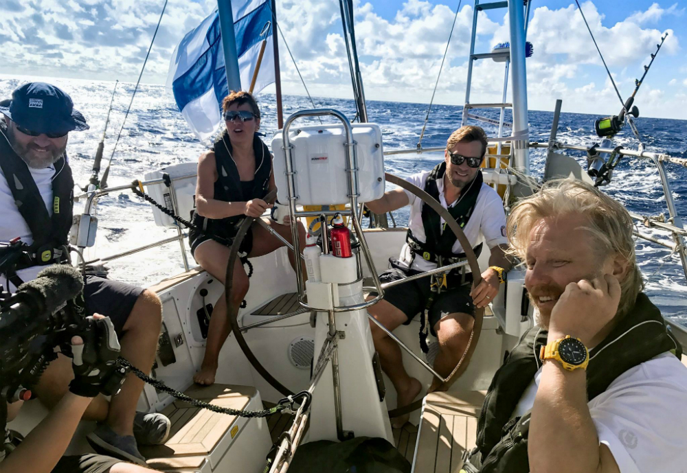 Cameramen and crew on a sailing boat.