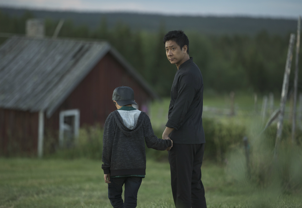 Master Cheng holding his son's hand.