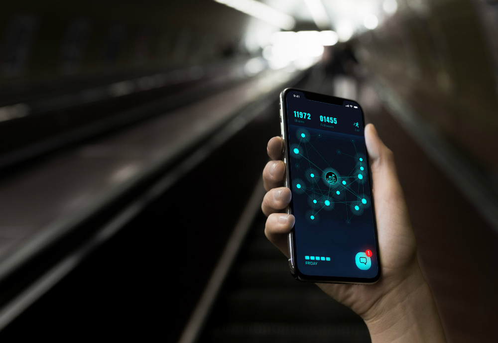 Hand holding a smartphone against a tunnel