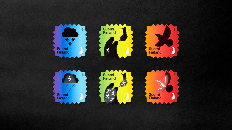 Colourful stamps against a black background.