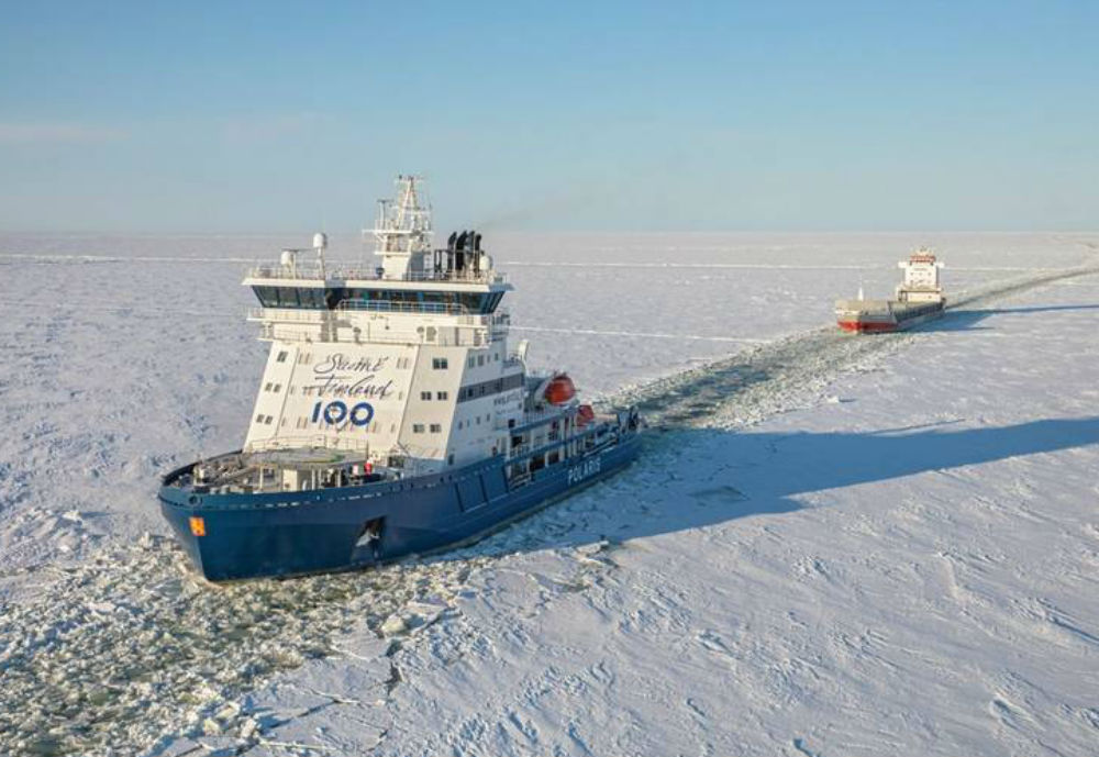 An icebreaker opening a route in the ice for a vessel