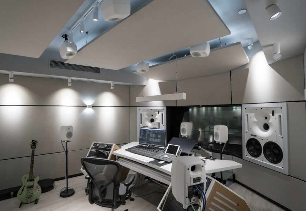 Audio studio with speakers and mixing table