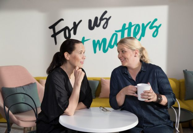 two women having coffee at table