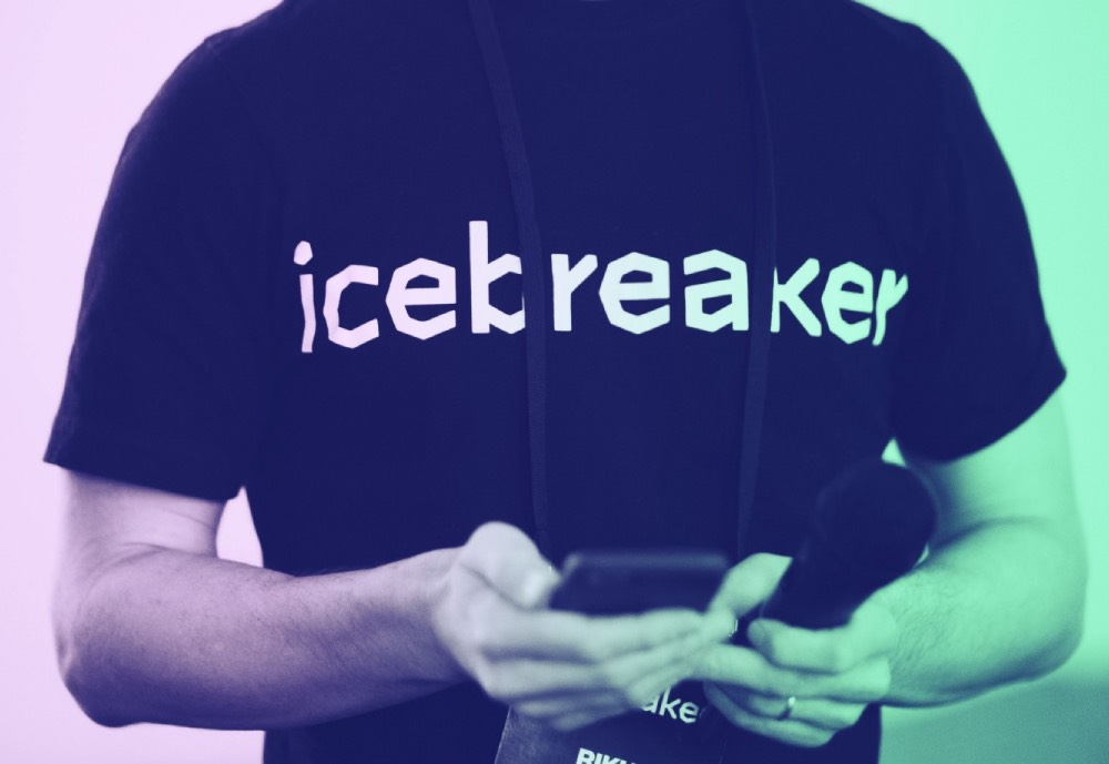 A person wearing an Icebreaker t-shirt