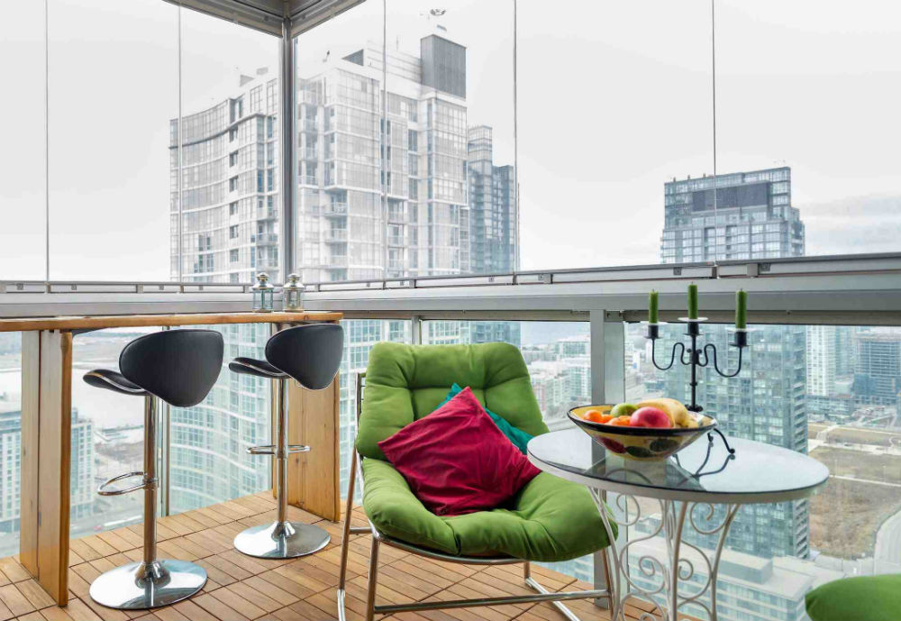 Glassed balcony with chairs and table