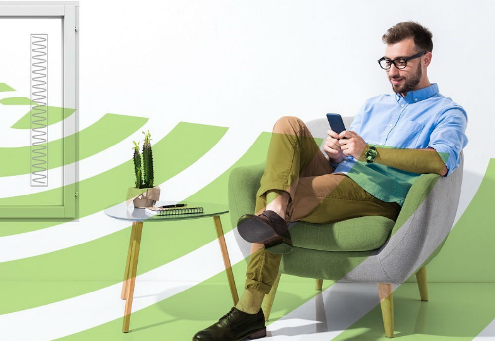 Man sitting on chair and looking at mobile phone