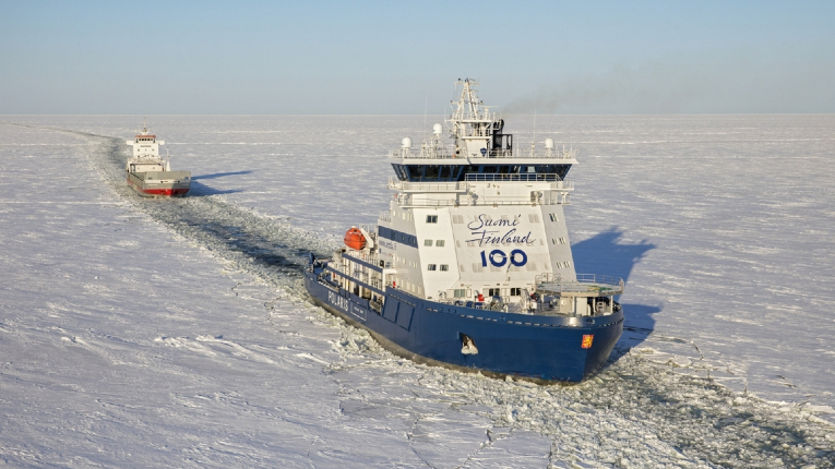 LNG-powered icebreaker Polaris clearing path for merchant vessel in deep ice
