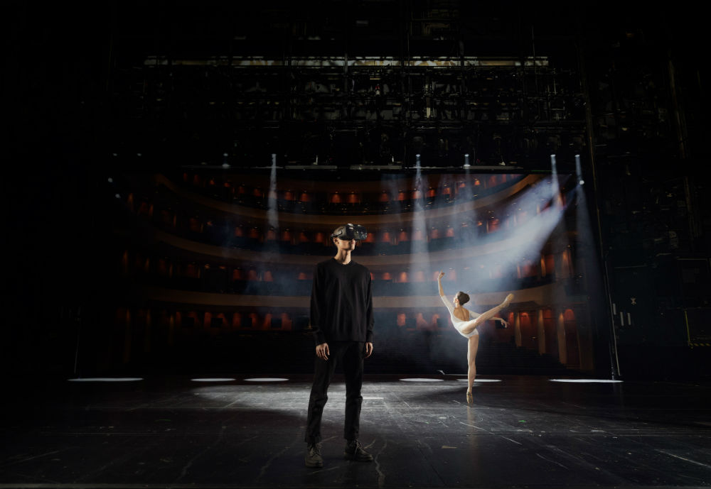 Man with VR headset in front of a ballet dancer