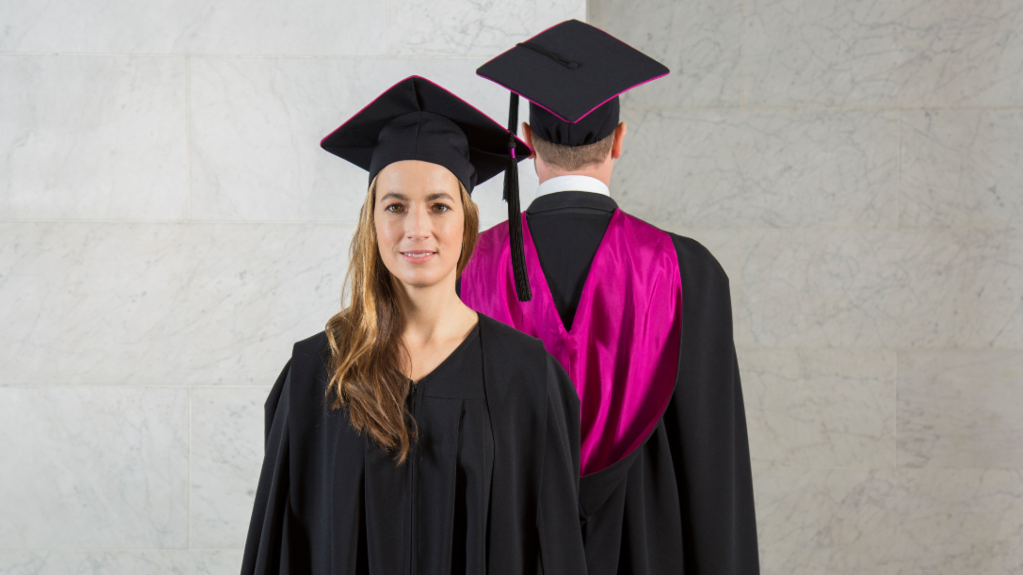 woman and man in graduation attire
