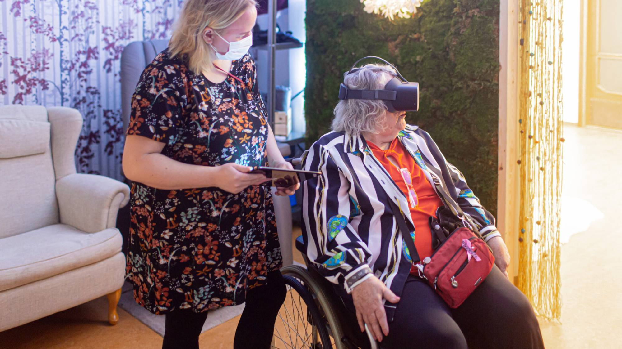 healhcare professional and patient with VR goggles on