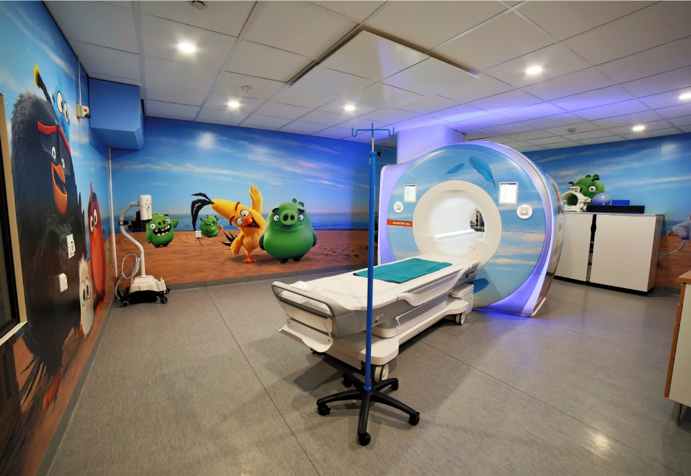 A MRI scan room in a hospital decorated with Angry Birds wallpaper
