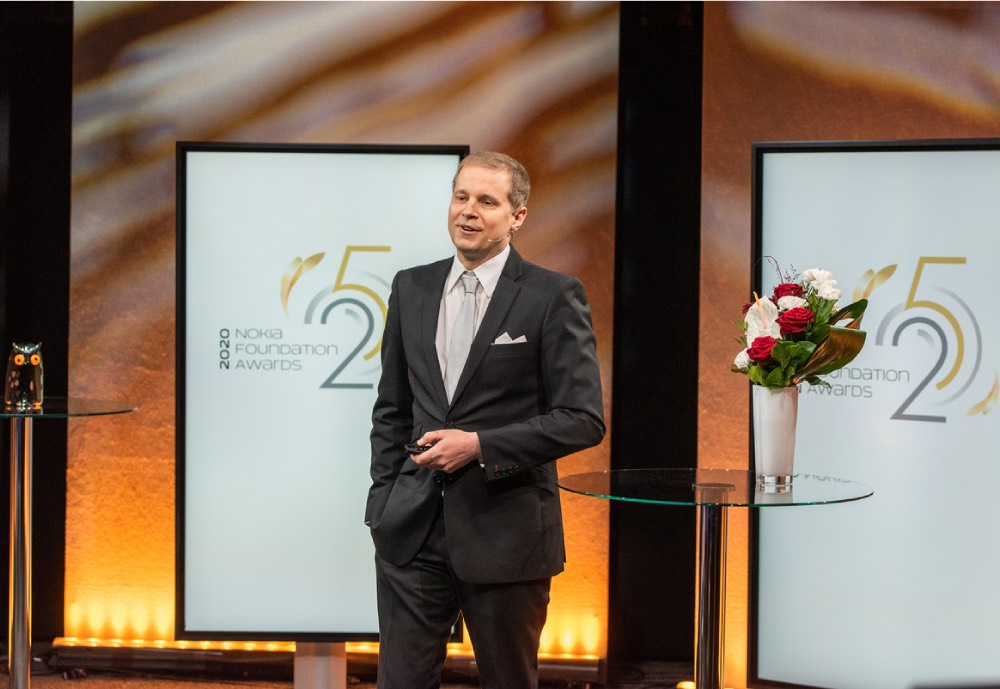 A suited man at an award ceremony