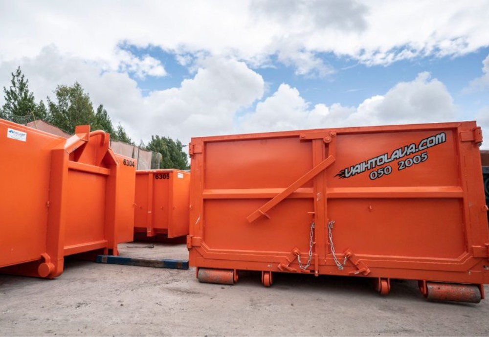 Orange containers that can be loaded on trucks