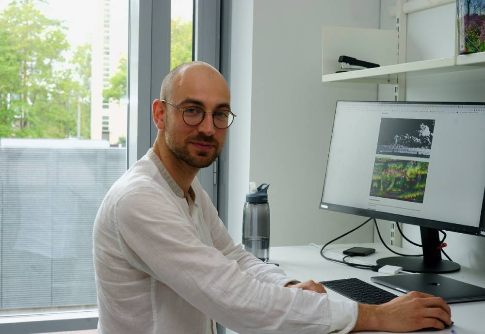 photo of researcher at his computer