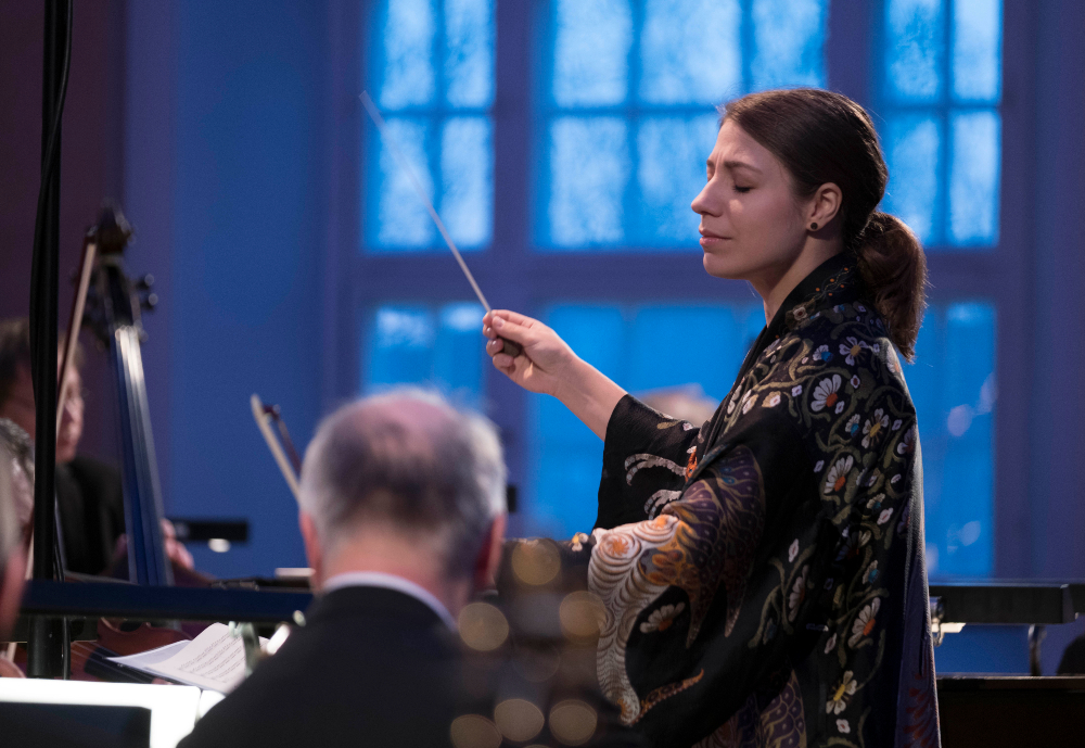 female conductor conducting