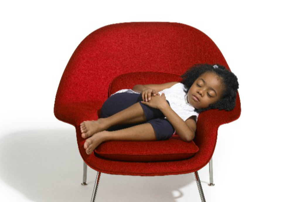 child sleeping in red chair