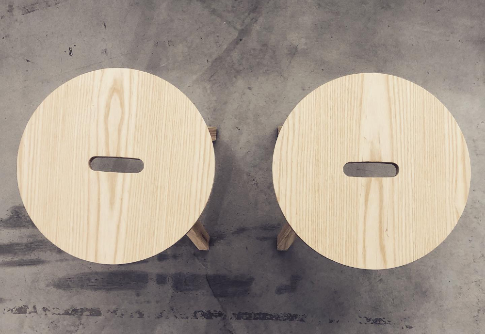two wooden stools side by side