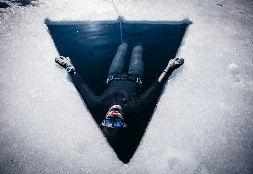 A diver ready to plunge through ice