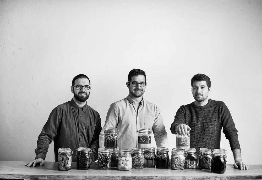 three restaurant owners posing with fermented food