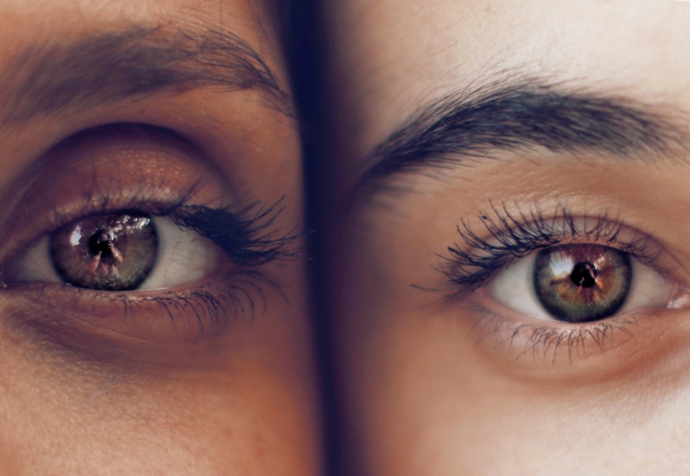 Two people's eyes up close