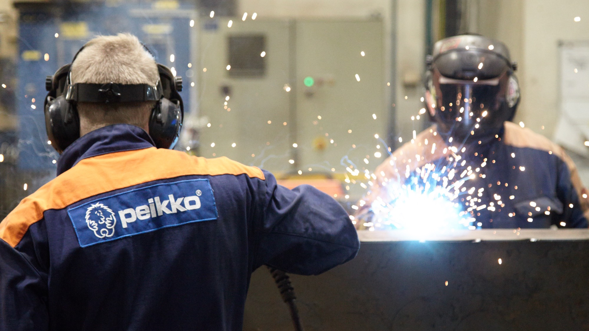 Peikko workers welding