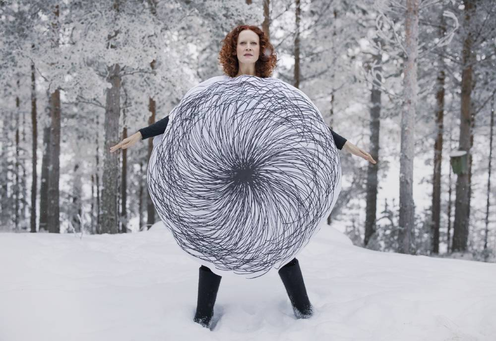red-haired woman with eccentric clothing